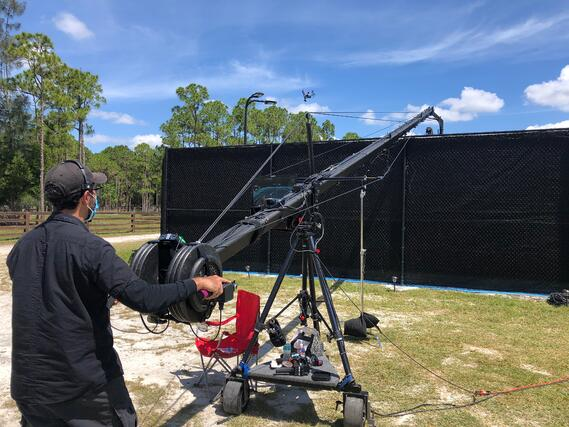 Operator using a jib at tennis event